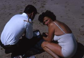 Unknown man and Phyliss Snider on a beach