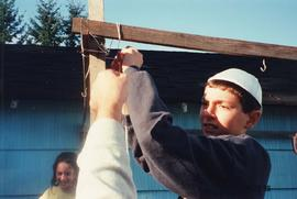 [Children constructing sukkah]