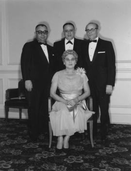 Mrs. Lil Shapiro with three unidentified men, Jewish National fund event