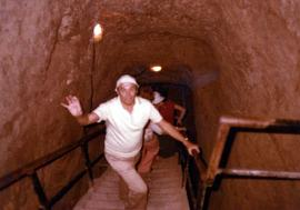 Ben Dayson climbing out of archaeological tunnel in Israel