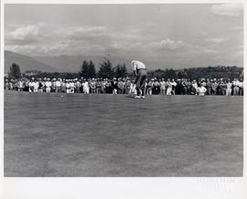 Golfer putting, audience attending, Shaughnessy Golf Club