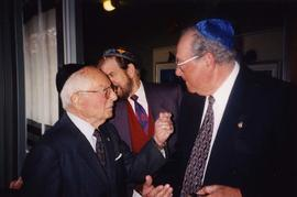 [Dr. Irving Snider speaking with an unknown man and both men are wearing kippahs]