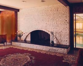 A stone fireplace and hearth, Interior of the Ross Residence, Vancouver, BC