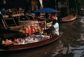 Man on a boat selling goods