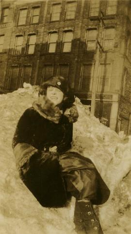 Birtie Boyanner, sitting in a snowbank in Vancouver, British Columbia