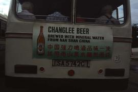 "Back of a bus with a sign that reads: ""Changlee Beer"""