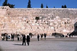 Western Wall with blue sky and unidentified people milling around in front