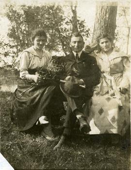 Sonia Victor (nee Nemetz), Harry Nementz [and an unidentified woman seated in a garden]
