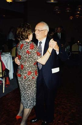 [Unknown woman dancing with Dr. Irving Snider at an unknown event]
