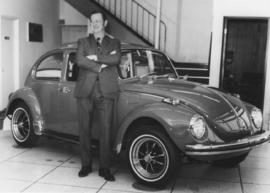 Man in front of VW Beetle, Bima Ball