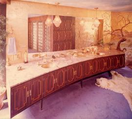 Marble countertop and cherry panelled cabinets, the interior washroom of the Ross residence, Vanc...