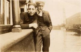 Harry Seidelman (left) and unidentified man leaning on railing of ship