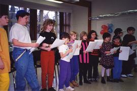 [Purim (possibly) - children singing / reading]