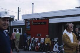 Building with several golf bags lined up leaning against the wall