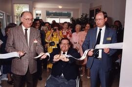 (Gov't.) cutting ribbon