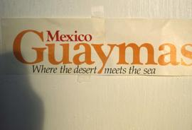 "Sign that reads: ""Mexico Guaymas, Where the desert meets the sea"""