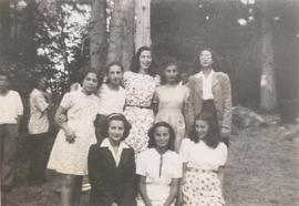 Unidentified adolescents standing outdoors