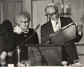 'Evening Honorers,' Jack Diamond and Chava Wosk standing at podium on Abrasha Wosk Testimonial Ev...