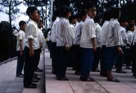 Group of children in uniform standing in formation