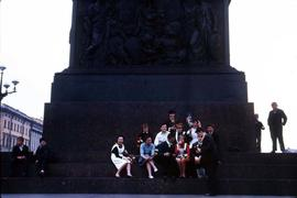 People sitting on the steps of an unidentified monument