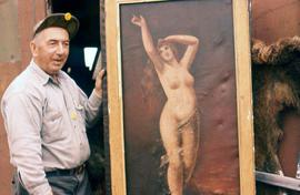 Man standing next to a painting