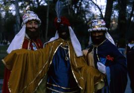 Three unknown boys wearing costumes