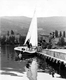 Young people on dock, sailboat, Camp Hatikvah, Oyama, BC