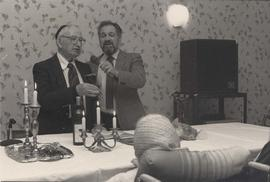 Rabbi Solomon and unidentified man at religious service