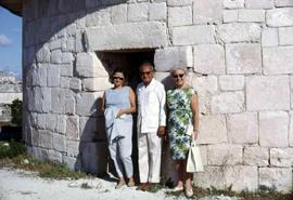 Phyliss Snider and two others posing in front of a stone building