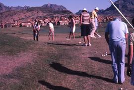 Group of unknown people on a golf course