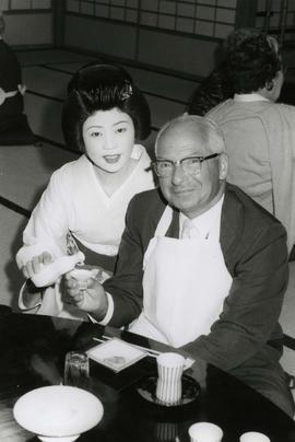 [Dr. Irving Snider posing with an unknown woman in Japanese traditional dress]