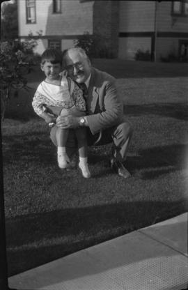 Judy and her father Dr. Morris in yard