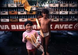Two children carrying bread