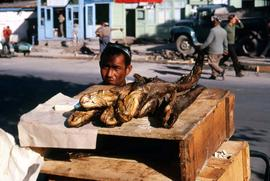 Man selling dried fish in the market