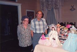 Esther and Ben Dayson, with display of dolls dressed in costumes made by Esther