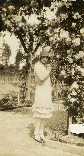Esther Nemetz [posing in a garden]