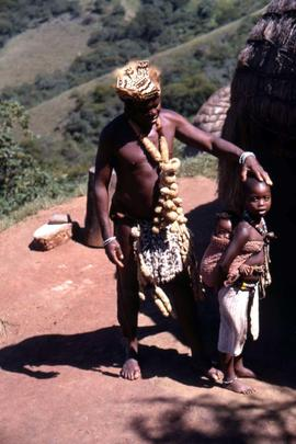 Unidentified South African  man and child in traditional ethnic dress