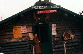 Phyliss Snider standing in front of the doorway of a lodge in Boundary, Alaska, close to the U.S/...