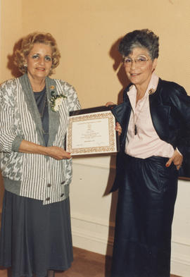 Two women with certificates