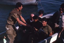 Uniformed men in a rowboat