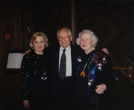 60th anniversary [- Dr. Irving and Phyliss Snider and an unknown woman posing for the camera]