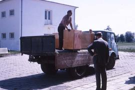 Three people unloading a truck