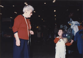 Woman and child with balloons, Hadassah Bazaar