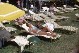 Unknown woman sun tanning on a lounge chair