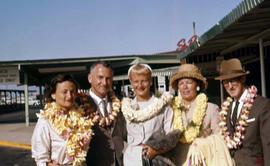 Phyliss Snider and four other unknown people wearing leis
