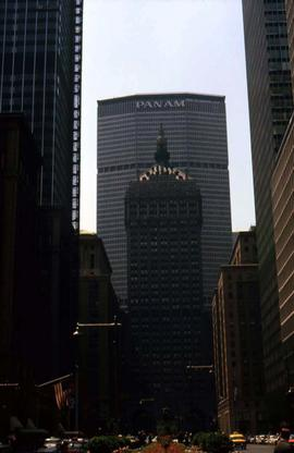 "Building in the centre of the image with a building behind it with ""Pan Am"" written on ..."