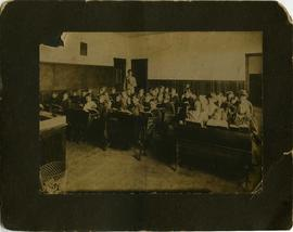 Seidelman children in classroom with group of unidentified children at Macdonald School