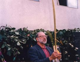 Unidentified man holding lulav and etrog