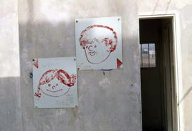 Two cartoon drawings of a man and a woman's heads