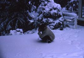 Probably Irving Snider crouching in the snow taking a picture
